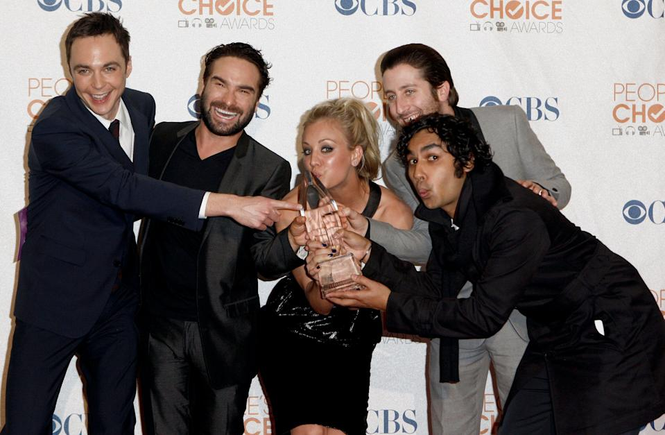 """From left, Jim Parsons, Johnny Galecki, Kaley Cuoco, Simon Helberg and Kunal Nayyar of """"The Big Bang Theory"""" hold the award for favorite television comedy at the People's Choice Awards on Wednesday Jan. 6, 2010, in Los Angeles. (AP Photo/Matt Sayles)"""