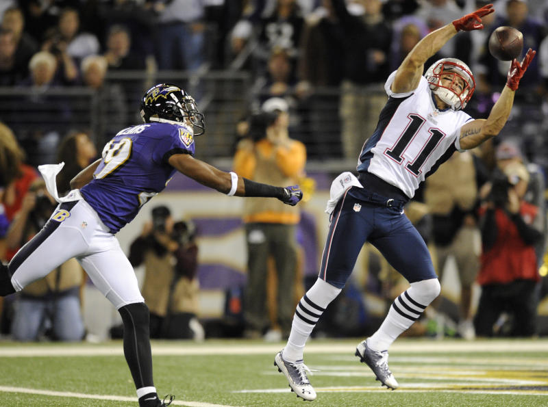 New England Patriots wide receiver Julian Edelman (11) can't hold onto a pass attempt as he is pressured by Baltimore Ravens cornerback Cary Williams in the first half of an NFL football game in Baltimore, Sunday, Sept. 23, 2012. (AP Photo/Nick Wass)