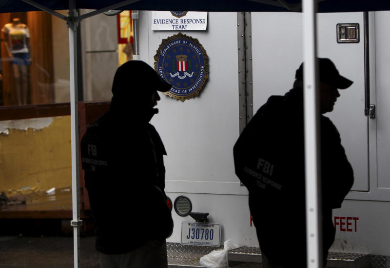 Investigators work at the crime scene in connection to the 1979 disappearance of 6-year-old boy Etan Patz in New York, Sunday, April 22, 2012. Heavy rains expected in the region halted the investigation on Sunday, but work in the basement is expected to resume Monday morning. (AP Photo/Seth Wenig)