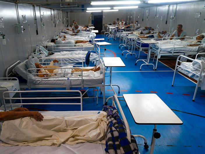 Covid patients are treated at a field hospital set up at a sports gym, in Santo Andre, Sao Paulo state, Brazil, in March (AFP via Getty Images)