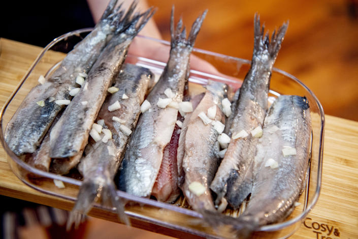 ROTTERDAM, NETHERLANDS - 2020/06/11: Soused herring being prepared for nurses during the event. Hollandse Nieuwe offers its soused herring as a token of appreciation to Intensive Care staff who have been on the front line during the coronavirus crisis at Erasmus MC hospital. (Photo by Robin Utrecht/SOPA Images/LightRocket via Getty Images)