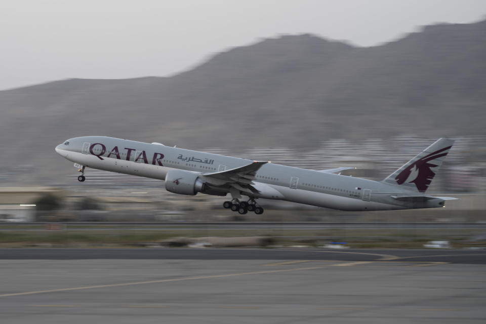 A Qatar Airways aircraft takes off with foreigners from the airport in Kabul, Afghanistan, Thursday, Sept. 9, 2021. Some 200 foreigners, including Americans, flew out of Afghanistan on an international commercial flight from Kabul airport on Thursday, the first such large-scale departure since U.S and foreign forces concluded their frantic withdrawal at the end of last month. (AP Photo/Bernat Armangue)
