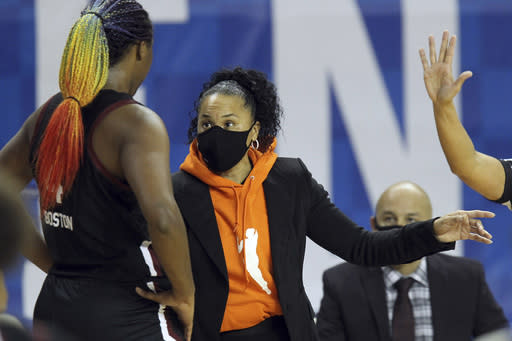 South Carolina's Aliyah Boston, left, receives instructions from South Carolina head coach Dawn Staley during the second half of an NCAA college basketball game against Kentucky in Lexington, Ky., Sunday, Jan. 10, 2021. (AP Photo/James Crisp)