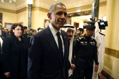 U.S. President Obama walks with Saudi King Salman at Erga Palace in Riyadh