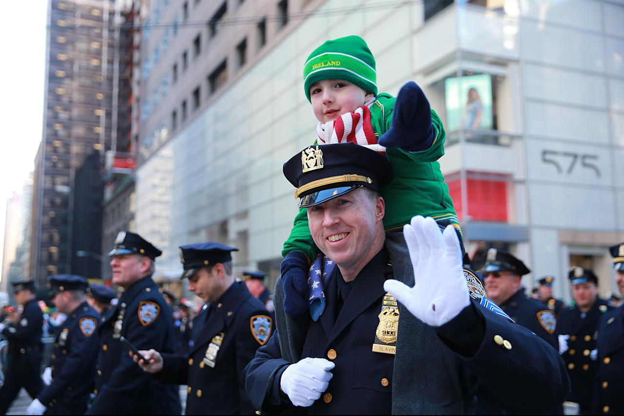 <p><span>The son of a New York City police officer gets a ride as his dad marches in the St. Patrick's Day parade on March 17, 2017, in New York. (Gordon Donovan/Yahoo News)</span> </p>