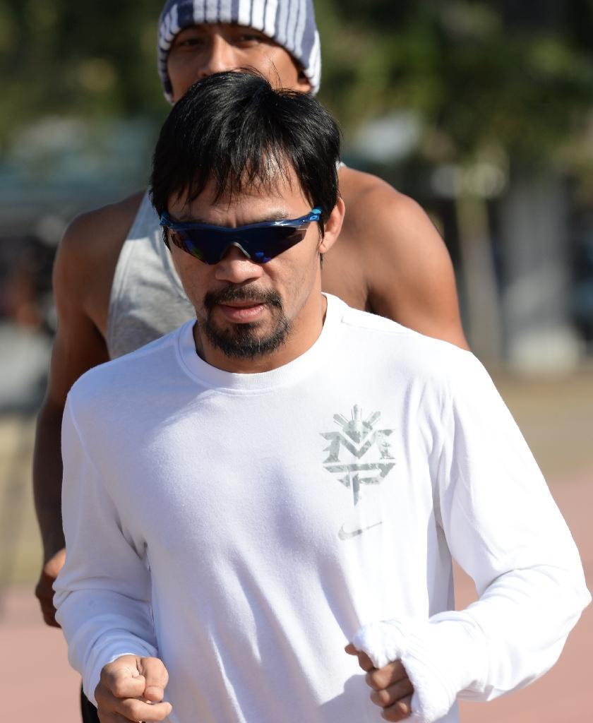 Manny Pacquiao is widely popular in the Philippines, where he is running for a seat in the Senate in May elections, a higher-profile national post than his current seat in the House of Representatives (AFP Photo/Ted Aljibe)