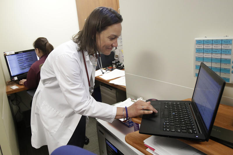In this April 9, 2019 photo, Dr. Megan Mahoney types into a computer at the Stanford Family Medicine office in Stanford, Calif. (Photo: AP Photo/Jeff Chiu)