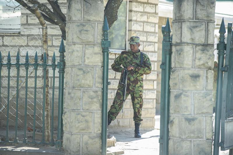 A soldier stands guard in front of an official building on September 01, 2014 in Maseru, Lesotho (AFP Photo/Mujahid Safodien)