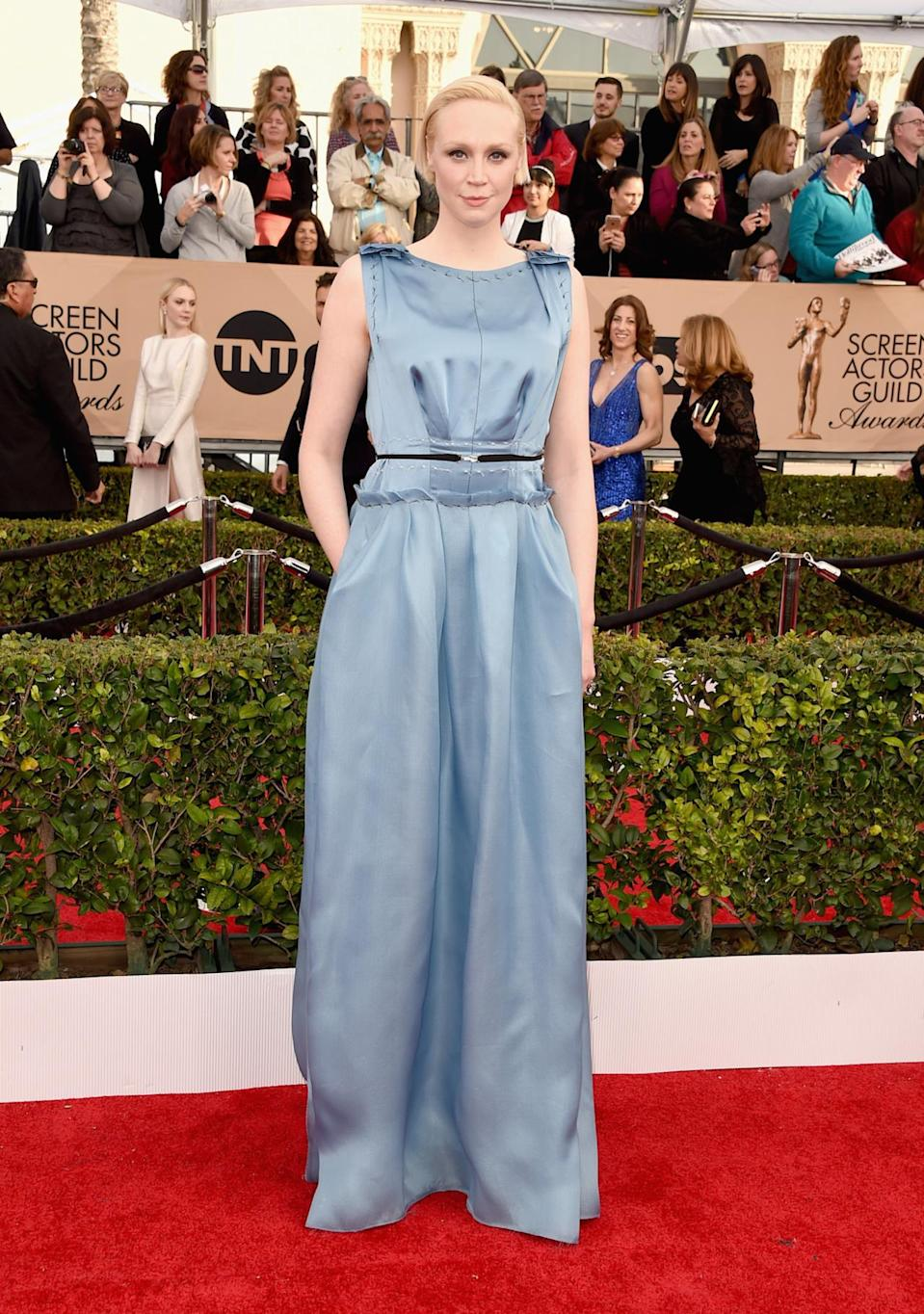 <p>Gwendoline Christie, who wouldn't give up any <i>Game of Thrones </i>spoilers, opted for a Victorian inspired silk dress. <i>Photo: Getty Images</i></p>