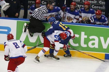 Russia's Yegor Yakovlev (44) checks Sweden's Mattias Sjogren (15) during their men's ice hockey World Championship semi-final game at Minsk Arena in Minsk May 24, 2014. REUTERS/Alexander Demianchuk