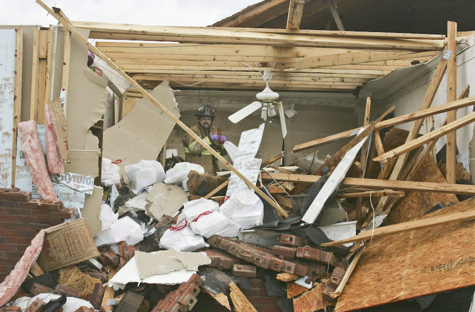 Andrew Ridnour salvages items from his home  in East Limestone County, Ala., on  Friday. March 2, 2012.  A reported tornado destroyed several houses in northern Alabama as storms threatened more twisters across the region Friday  (AP Photo/The Huntsville Times, Robin Conn)