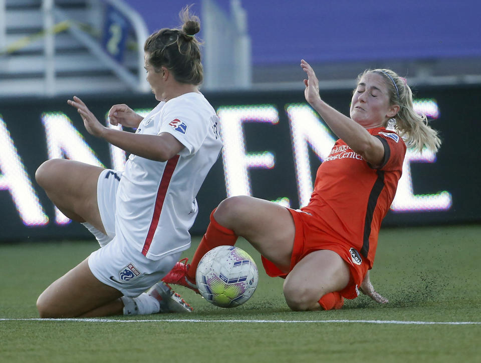OL Reign defender Amber Brooks, left, defends against Houston Dash midfielder Bri Visalli, right, during the first half of an NWSL Challenge Cup soccer match at Zions Bank Stadium, Saturday, July 4, 2020, Herriman, Utah. (AP Photo/Rick Bowmer)