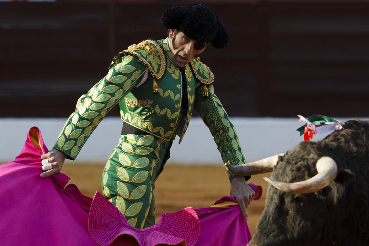 Spanish bullfighter Juan Jose Padilla performs during a bullfight in the southwestern Spanish town of Olivenza, Sunday, March 4, 2012. Padilla, who lost sight in one eye and has partial facial paralysis after a terrifying goring returned to the bullring Sunday, five months after his injury.   (AP Photo/Daniel Ochoa de Olza)