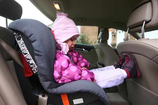 Embargoed to 0001 Monday February 16. EDITORS PLEASE NOTE PICTURE POSED BY MODEL. A young girl prepares for a journey in a child's car seat near Ashford in Kent, as a survey reveals two in three car seats are not fitted properly.