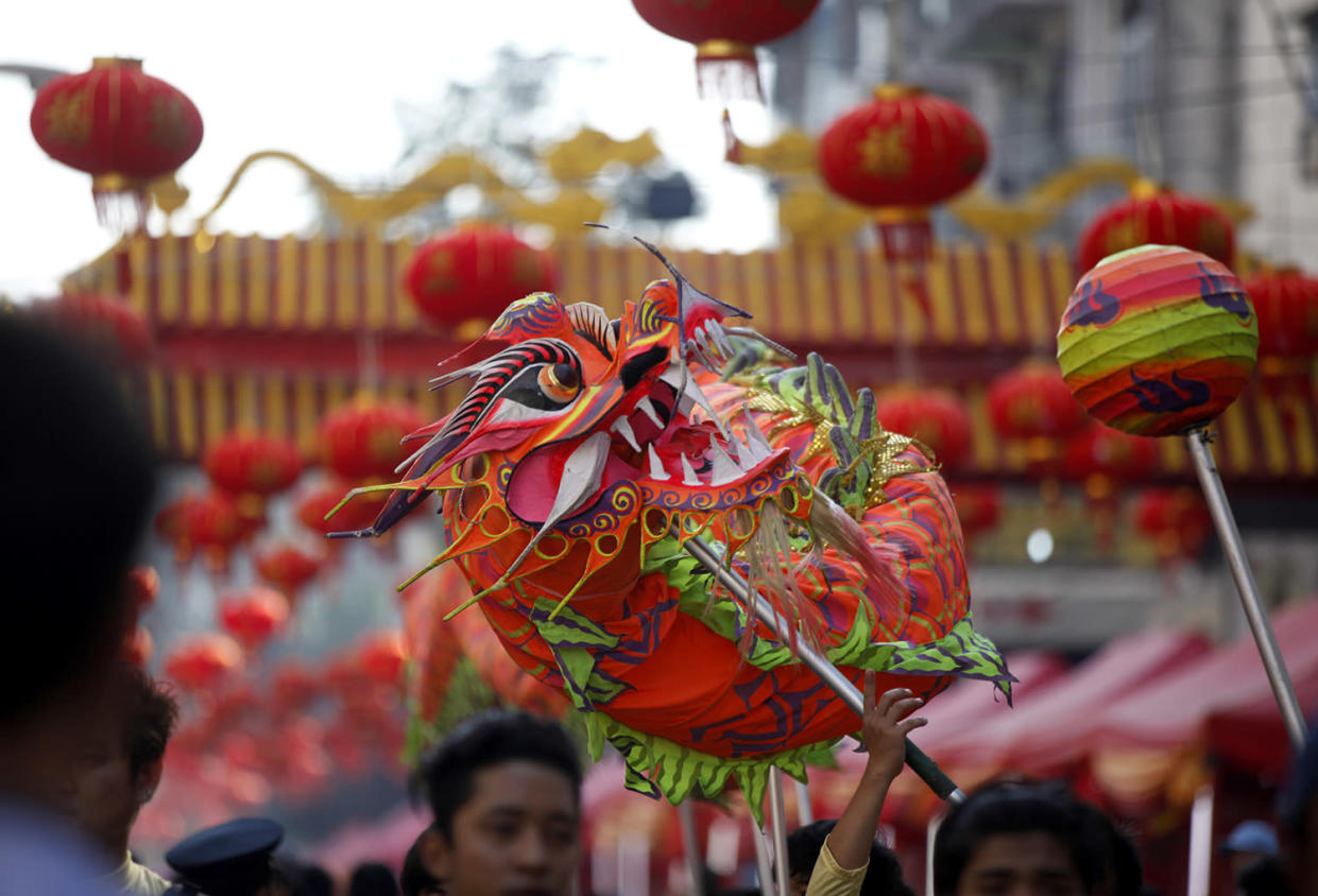 Local Chinese artists perform a dragon dance during celebrations to mark Lunar New Year at Chinatown Saturday, Jan. 28, 2017, in Yangon, Myanmar. Saturday marks the Year of the Rooster in the Chinese calendar. (AP Photo/Thein Zaw)