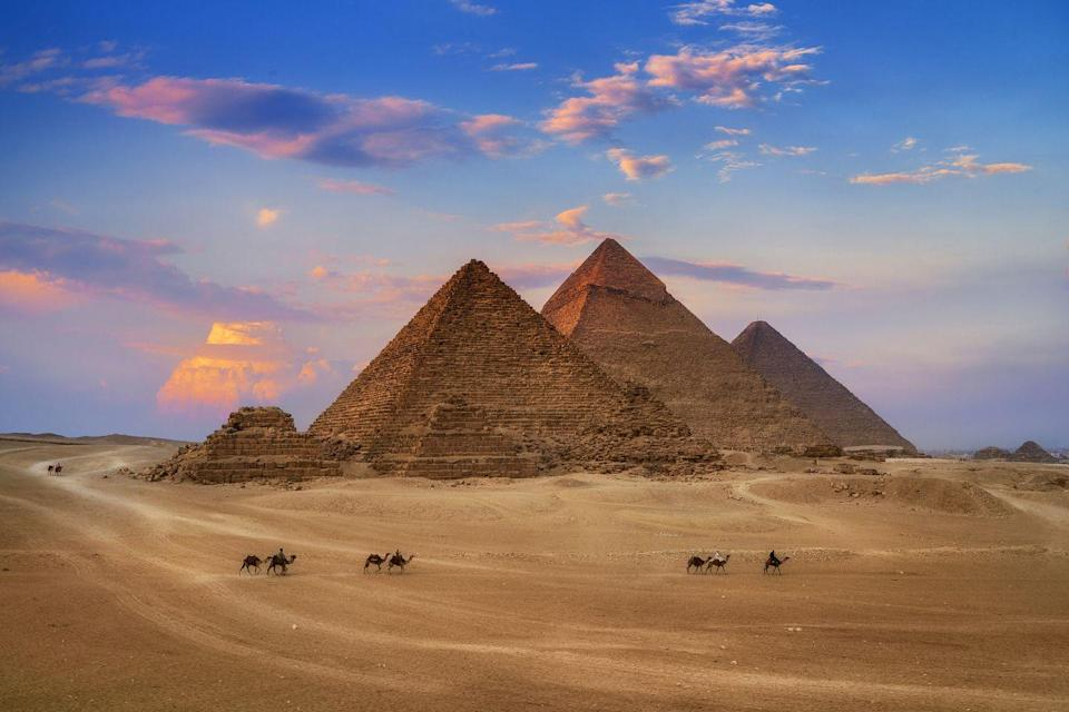 """<p>Historians <a href=""""https://www.britannica.com/topic/Pyramids-of-Giza"""" rel=""""nofollow noopener"""" target=""""_blank"""" data-ylk=""""slk:estimate"""" class=""""link rapid-noclick-resp"""">estimate</a> that it took approximately 100,000 workers several decades to complete the Pyramids.</p>"""