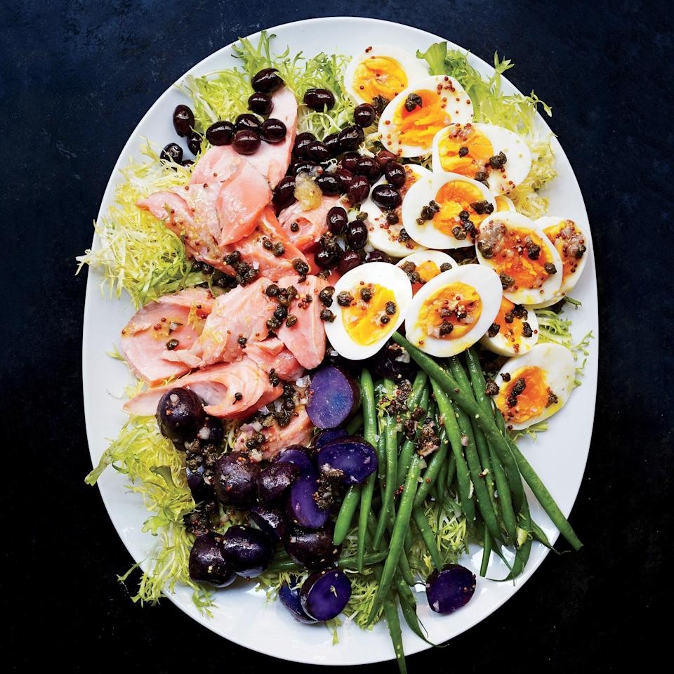 "While niçoise is traditionally made with tuna, we think salmon works equally well, if not better. <a href=""https://www.epicurious.com/recipes/food/views/salmon-nicoise-56389407?mbid=synd_yahoo_rss"" rel=""nofollow noopener"" target=""_blank"" data-ylk=""slk:See recipe."" class=""link rapid-noclick-resp"">See recipe.</a>"