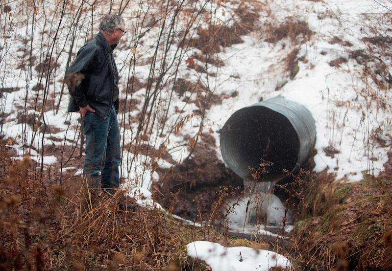 David Huff, chair of the zoning and planning commission for Osceola Township, stands before Chippewa Creek, shown flowing through a culvert where global food conglomerate Nestle is in a battle with critics in the tiny town over its water extraction. (Photo: STEVEN M. HERPPICH via Getty Images)