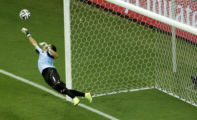 Costa Rica's goalkeeper Keylor Navas dives for a save during the World Cup quarterfinal soccer match between the Netherlands and Costa Rica at the Arena Fonte Nova in Salvador, Brazil, Saturday, July 5, 2014. (AP Photo/Themba Hadebe)