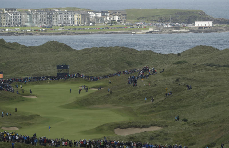 Northern Ireland's Rory McIlroy plays his approach shot to the 7th green during the first round of the British Open Golf Championships at Royal Portrush in Northern Ireland, Thursday, July 18, 2019.(AP Photo/Matt Dunham)