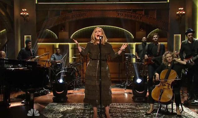 <p>Not only is Adele a Thanksgiving Miracle, her songs holding the magical ability to make every family member get along for the length of one song, she also wore the perfect outfit for the upcoming holiday meal (even though she's British). As the musical guest on <i>Saturday Night Live</i>, the <i>25</i> artist wore a long-sleeved fringe dress from Burberry. </p>