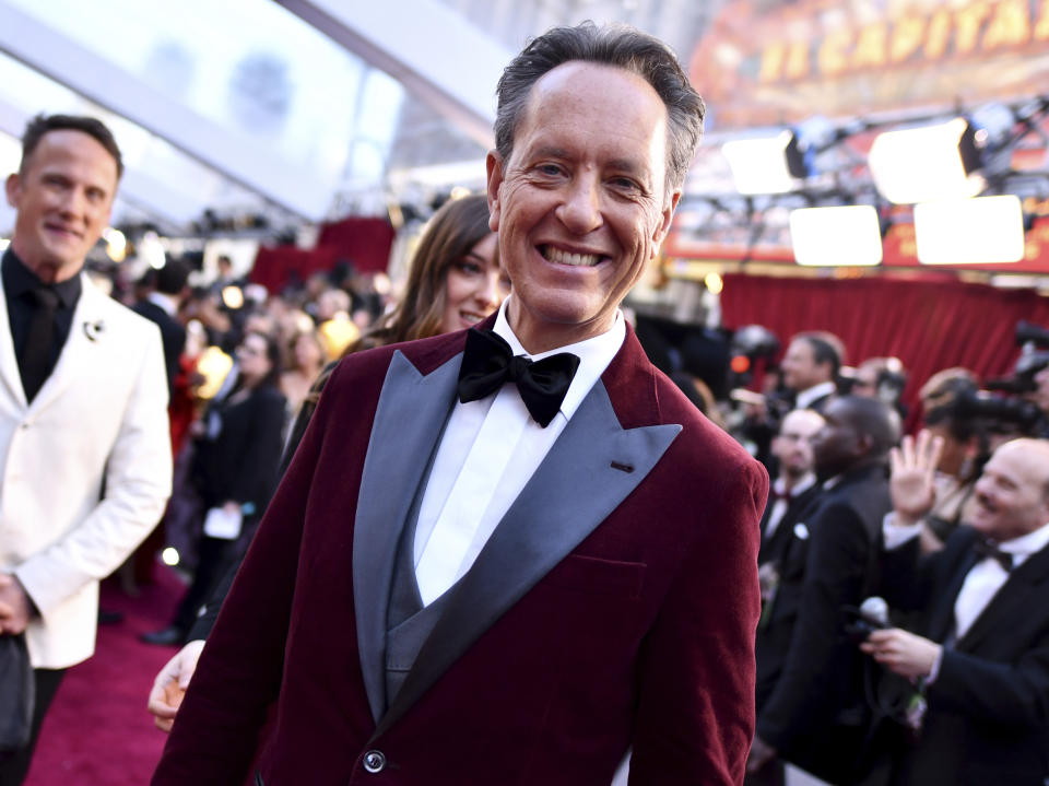 Richard E. Grant arrives at the Oscars on Sunday, Feb. 24, 2019, at the Dolby Theatre in Los Angeles. (Photo by Charles Sykes/Invision/AP)