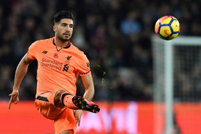 Liverpool's midfielder Emre Can passes the ball during the English Premier League football match against West Ham United November 4, 2017