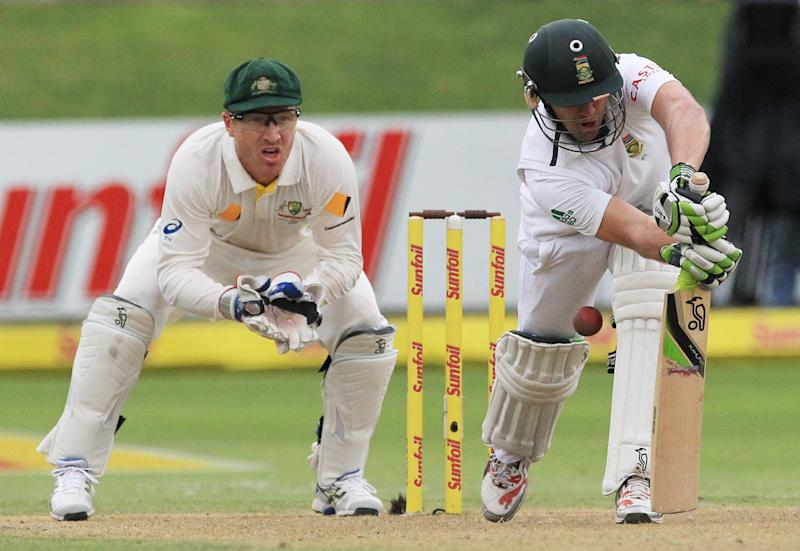South Africa's batsman AB de Villiers, right, plays a shot as Australia's wicketkeeper Brad Haddin, left, watches on the first day of their 2nd cricket test match at St George's Park in Port Elizabeth, South Africa, Thursday, Feb. 20, 2014. (AP Photo/ Themba Hadebe)