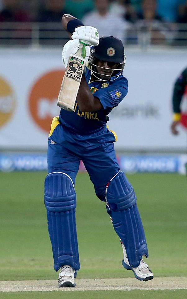 DUBAI, UNITED ARAB EMIRATES - DECEMBER 13:  Kusal Janith Perera bats during the second Twenty20 International match between Pakistan and Sri Lanka at Dubai Sports City Cricket Stadium on December 13, 2013 in Dubai, United Arab Emirates.  (Photo by Francois Nel/Getty Images)