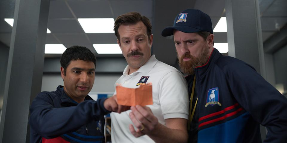 Nick Mohammed, Jason Sudeikis, and Brendan Hunt in 'Ted Lasso,' premiering globally on Friday, August 14, on Apple TV+.