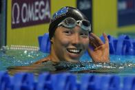 Torri Huske reacts after winning the Women's 100 Butterfly during wave 2 of the U.S. Olympic Swim Trials on Monday, June 14, 2021, in Omaha, Neb. (AP Photo/Jeff Roberson)