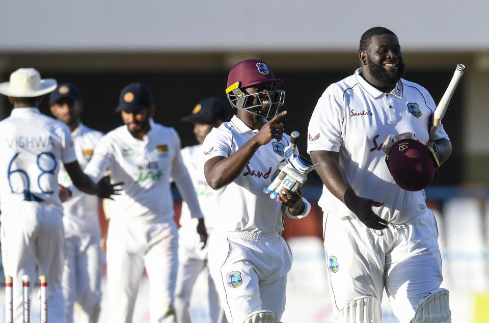 Rahkeem Cornwall (pictured right) and Kemar Roach (pictured left) of West Indies walk off the field at the end of day 2 of the 1st Test between West Indies and Sri Lanka at Vivian Richards Cricket Stadium.