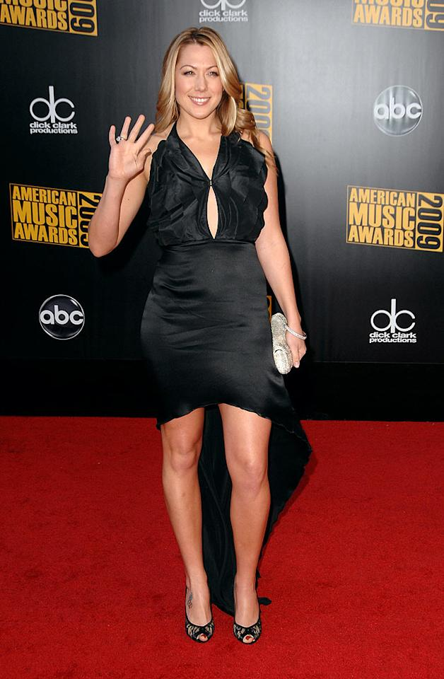 "Colbie Caillat  Grade: B  The ""Bubbly"" songbird delivered some unexpected drama in a divine black dress and lace peep-toes. Steve Granitz/a href=""http://www.wireimage.com"" target=""new"">WireImage.com - November 22, 2009"