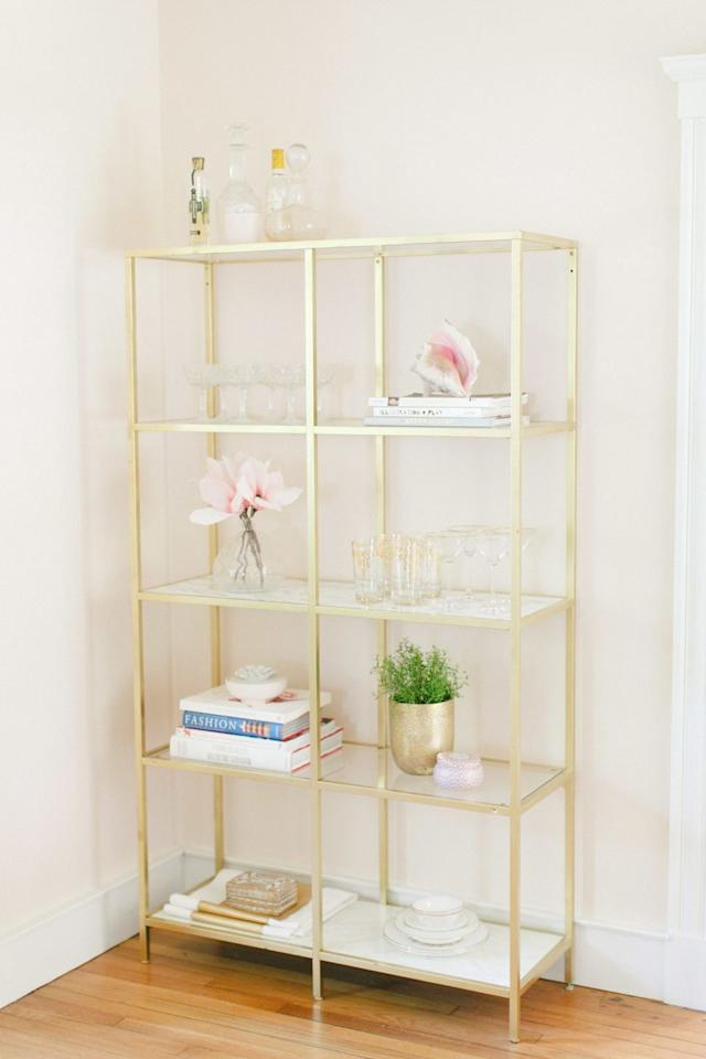 """<p>Turn a simple IKEA bookshelf into this pretty piece with marble contact paper and gold spray paint. Complete your display with stacked books and feminine décor.<br></p><p><strong>See more at <a href=""""https://www.stylemepretty.com/living/2014/07/07/ikea-hack-gold-marble-shelves/"""" target=""""_blank"""">Style Me Pretty</a>. </strong></p><p><a class=""""body-btn-link"""" href=""""https://www.amazon.com/Marble-Contact-Granite-Decorative-Self-Adhesive/dp/B075R8N8NH?tag=syn-yahoo-20&ascsubtag=%5Bartid%7C10050.g.30770089%5Bsrc%7Cyahoo-us"""" target=""""_blank"""">SHOP CONTACT PAPER</a></p>"""