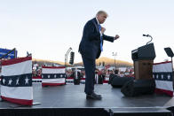 """In this Oct. 18, 2020 photo, President Donald Trump dances after speaking at a campaign rally at Carson City Airport, in Carson City, Nev. Trump, a man who is famously particular about his appearance, is fully embracing doing a dad dance to the Village People's """"YMCA"""" as the finale to his rallies in the campaign's closing stretch.(AP Photo/Alex Brandon)"""