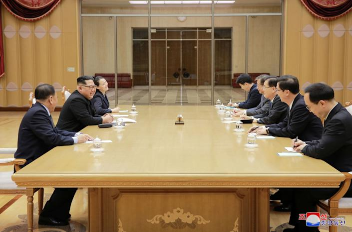 North Korean leader Kim Jong Un meets members of the special delegation of South Korea's President.