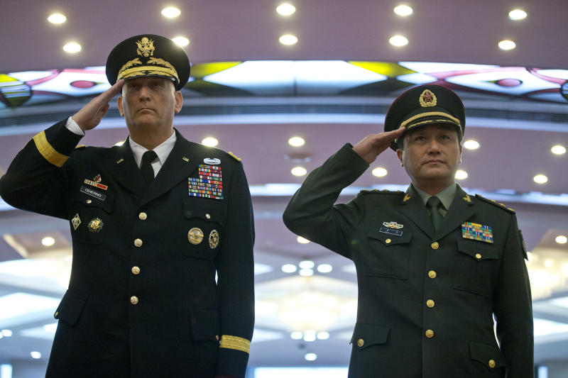 U.S. Army Chief of Staff Gen. Raymond Odierno, left, and Gen. Wang Ning, deputy Chief Staff of the People's Liberation Army (PLA), salute as they review an honor guard at China's Ministry of Defense in Beijing, Friday, Feb. 21, 2014. The U.S. Army chief met with top Chinese generals in Beijing Friday amid regional tensions and efforts to build trust between the two nation's militaries. (AP Photo/Alexander F. Yuan, Pool)
