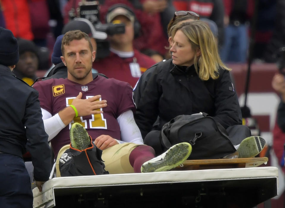The Redskins do not expect quarterback Alex Smith to play next season after the gruesome leg injury he suffered in Week 11. (Getty Images)