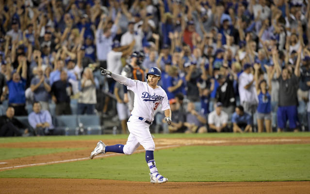 <p>Los Angeles Dodgers' Joc Pederson celebrates after his home run against the Houston Astros during the fifth inning of Game 2 of baseball's World Series Wednesday, Oct. 25, 2017, in Los Angeles. (AP Photo/Mark J. Terrill) </p>