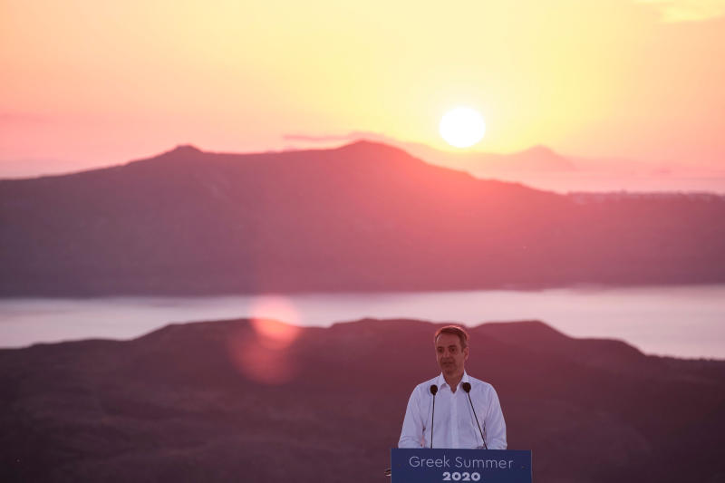 In this photo provided by the Prime Minister's Office, Greek Prime Minister Kyriakos Mitsotakis announces the opening of the tourist season during a news conference, on the Greek island of Santorini, Saturday, June 13, 2020. (Dimitris Papamitsos/Greek Prime Minister's Office via AP)