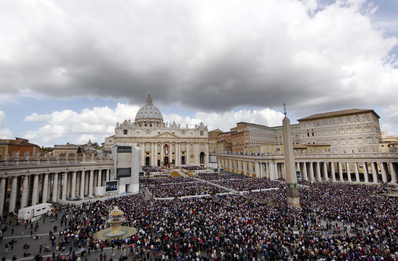 Faithful gather in St. Peter's Square at the Vatican during the Easter Mass celebrated by Pope Benedict XVI, Sunday, April 8, 2012. Pope Benedict XVI in his Easter Sunday message has urged the Syrian regime to heed international calls to end bloodshed and commit to dialogue. After celebrating Mass in St. Peter's Square, Benedict voiced hope that Easter's joy would comfort Christian communities suffering because of their faith. He denounced terrorist attacks in Nigeria that have hit Christians and Muslims alike and prayed for peace in coup-struck Mali. The pope struggled with hoarseness throughout the Mass before a crowd of more than 100,000 faithful. Only hours earlier he had led a three-hour nighttime Easter vigil inside St. Peter's Basilica. (AP Photo/Pier Paolo Cito)