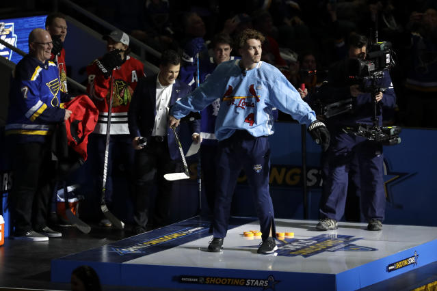 Calgary Flames' Matthew Tkachuk wears a St. Louis Cardinals jersey during the Skills Competition shooting stars event, part of the NHL All-Star weekend, Friday, Jan. 24, 2020, in St. Louis. (AP Photo/Jeff Roberson)