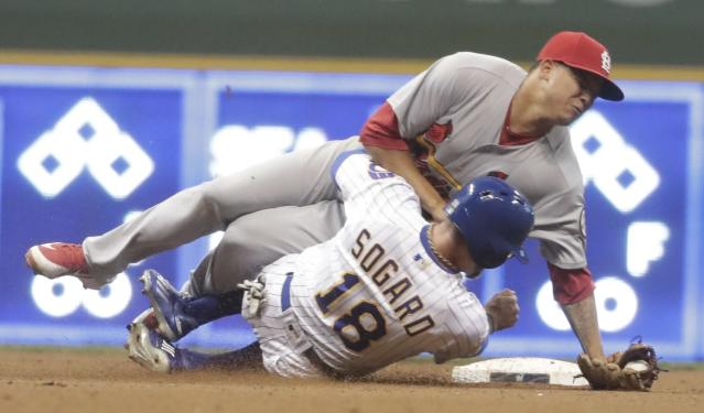 Milwaukee Brewers' Eric Sogard is out at second with St. Louis Cardinals' Yairo Munoz covering during the eighth inning of a baseball game Friday, June 22, 2018, in Milwaukee. Both teams cleared their benches after the play. (AP Photo/Morry Gash)