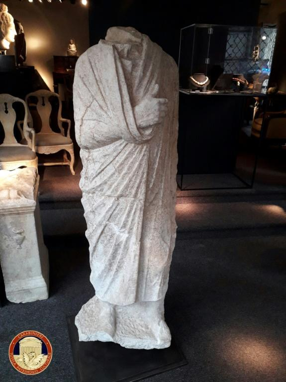 "The ""Togatus"" marble piece, a full-body, headless 1st century statue of a toga-wearing man, was looted in 2011 from a villa in Rome"