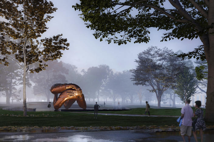 """This computer rendering provided by Mass Design Group, shows a memorial to Dr. Martin Luther King Jr. and Coretta Scott King, a 20-foot-high (6-meter-high) bronze sculpture called """"The Embrace"""", planned for the Boston Common in Boston. The memorial has received unanimous approval from a city panel, allowing construction to start, the group behind the memorial said Wednesday, May 26, 2021. (Mass Design Group via AP)"""