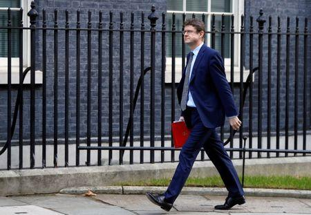 FILE PHOTO: Britain's Secretary of State for Business Greg Clark is seen outside of Downing Street in London, Britain, February 19, 2019. REUTERS/Peter Nicholls