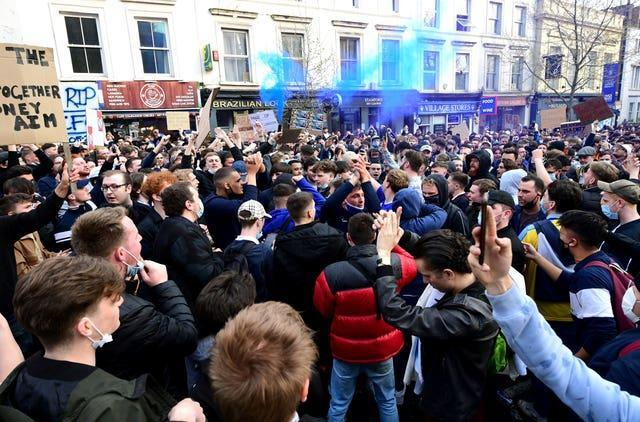 Chelsea fans protest against their club's Super League involvement before the Premier League game against Brighton