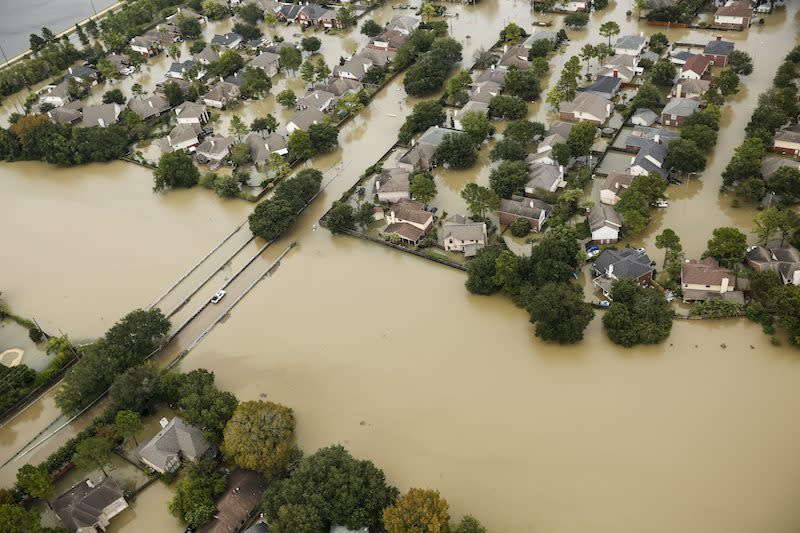 A Houston neighbourhood is devastated by in widespread flooding from Tropical Storm Harvey on Aug. 30, 2017. Photo from Brett Coomer/Houston Chronicle via The Associated Press.