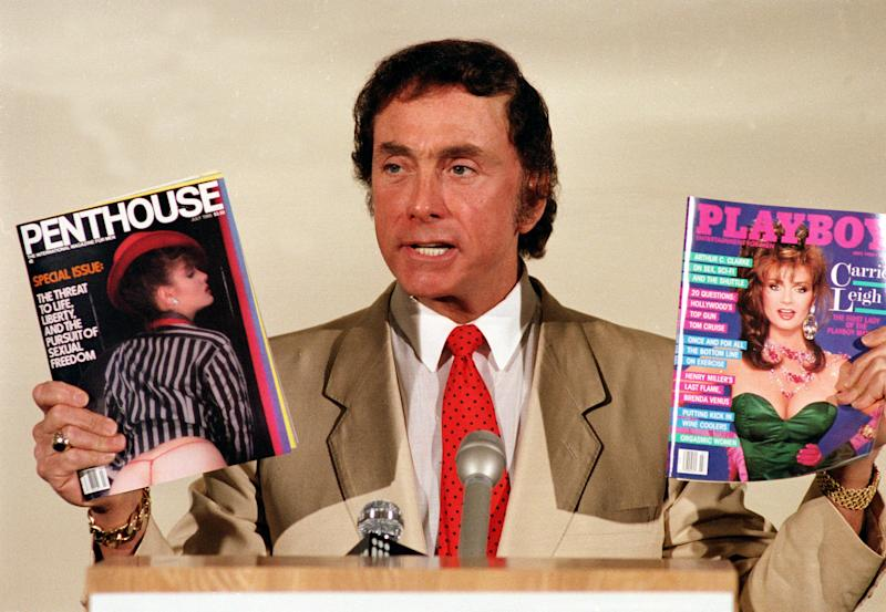 Penthouse publisher and founder Bob Guccione holds up his magazine Penthouse and Playboy magazine at a news conference announcing his anti-censorship campaign at Penthouse magazine offices in New York, June 4, 1986. (AP Photo/Richard Drew)