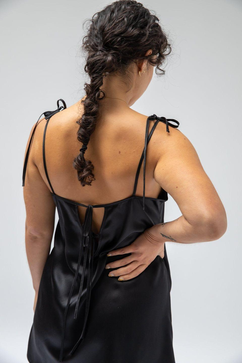 """<p><strong>La Sette</strong></p><p>lasette.shop</p><p><strong>$185.00</strong></p><p><a href=""""https://www.lasette.shop/products/tied-up-chemise"""" rel=""""nofollow noopener"""" target=""""_blank"""" data-ylk=""""slk:Shop Now"""" class=""""link rapid-noclick-resp"""">Shop Now</a></p><p>A sexy silk chemise is <em>such</em> a pretty option if you prefer a sleep dress. Bring a lingerie feel to bed with this 100 percent silk chemise that ties at the shoulders and back. </p>"""